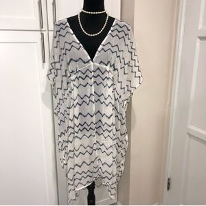 Sheer off white with blue lines cover up
